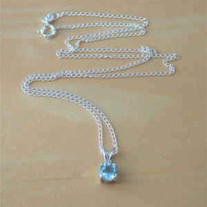 blue topaz solitaire pendant
