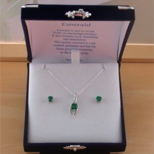 silver emerald necklace and earrings